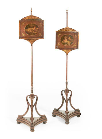 A pair of late Victorian polychrome decorated polescreens in the Sheraton revival style