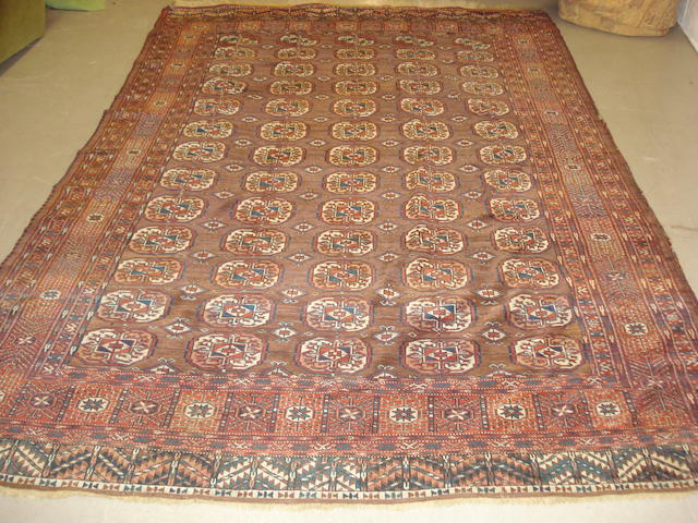 A Tekke carpet, West Turkestan, 300cm x 209cm together with another rug (2)