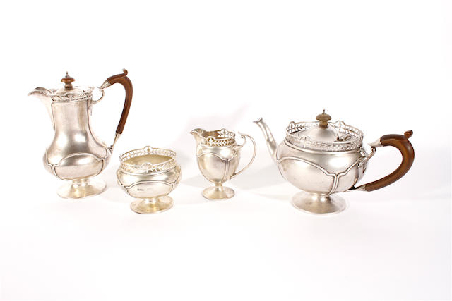 A four piece silver tea set by Mosley Flowers and Co, Birmingham and London 1912  (4)