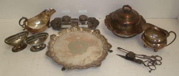 An Old Sheffield plate inkstand, with foliate border fitted with a pair of block glass inkwells of later date, the following Old Sheffield and electroplate a muffin dish, sauce boat, George II style shaped circular salver, milk jug, pair of slat pierced salts with glass liners, grape shears and candle snuffers, also an engraved brass box and two small dishes and a Victorian beadwork purse.