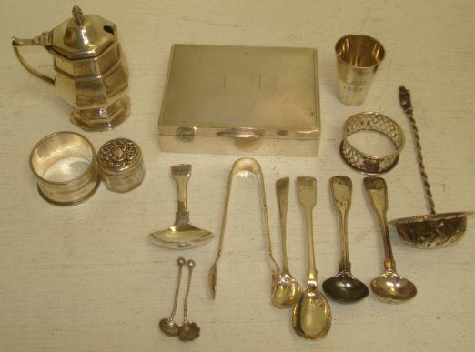 A modern silver cigarette box, Birmingham 1961, with hinged engine turned cover and the following silver an Edwardian mustard pot, 1901, in early 18th Century style, an Edwardian tot cup, 1906, George III fiddle and shell caddy spoon, 1816, four Georgian and William IV condiment spoons, Victorian napkin ring and another, small mounted glass dressing table jar, Victorian salt spoon, also three pieces of electroplate flatware.