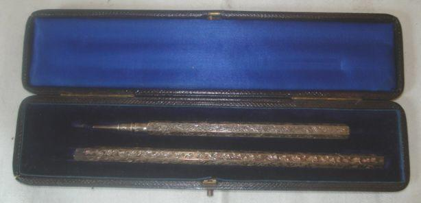 A cased silver desk pencil and dip pen, by S Mordan & Co, of hexagonal form, engraved with leafy scrolls.