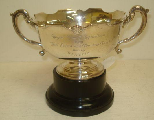 A George V silver trophy rose bowl, Adie Brothers, Birmingham 1928, in mid 18th Century style, with twin scrolled side handles inscribed 'Royal Yacht Squadron 1929 West Solent and Burnham Class Won by Suvretta', 23cm, 10ozs, ebonised plinth.