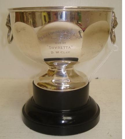 A George V silver trophy rose bowl, E Druiff & Co, Birmingham 1925, panelled circular with lion mask ring handles, inscribed 'Royal London Yacht Club ...... Won by Suvretta ....', 13.5cm, 9ozs, ebonised plinth.