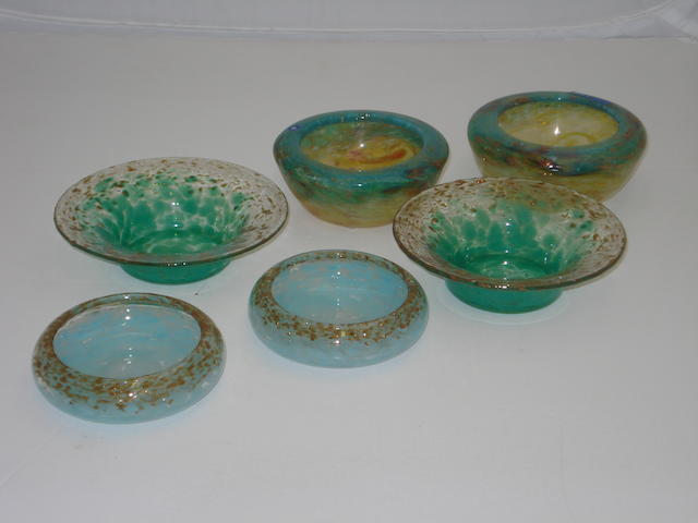 A collection of small Monart bowls