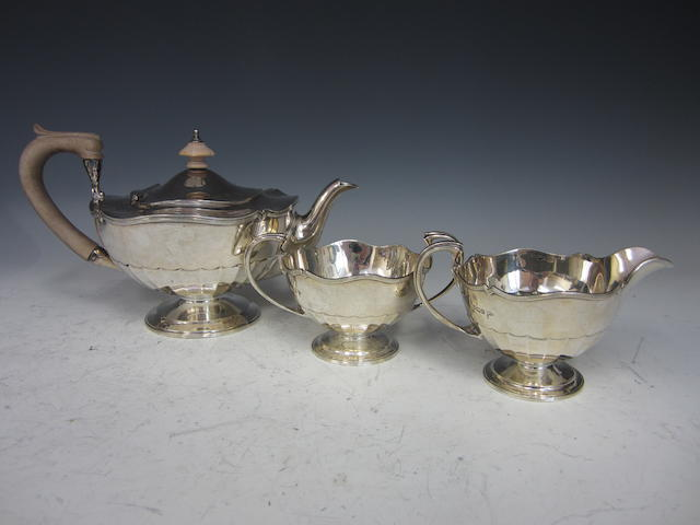A silver three piece tea service  by Walker and Hall,  Sheffield 1912/3/4  (3)