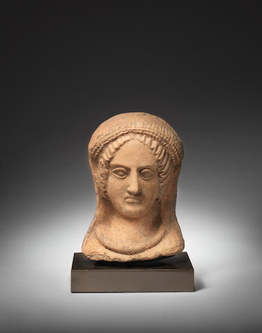 An Etruscan terracotta female head