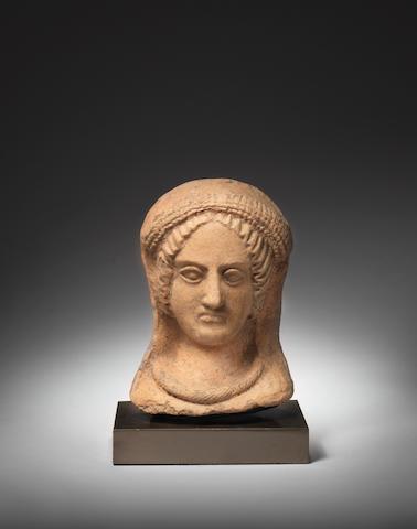 An Etruscan terracotta female head