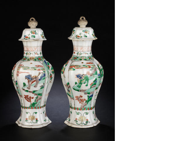 A pair of famille verte, lobed baluster vases and covers   Kangxi