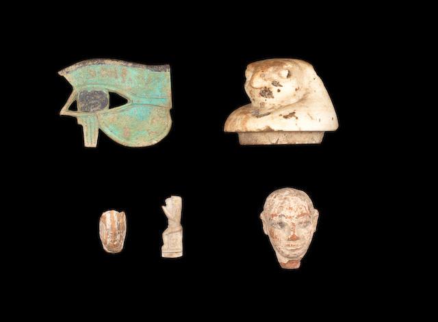 Five Egyptian objects: udjat eye(2), terracotta head(3), canopic jar lid(5), monkey(7) & cicada(8)