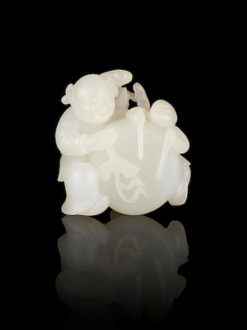 A white jade carving of two boys with a drum 18th century