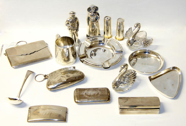 "A dolls size Christening mug,engraved with foliage and inscribed, Birmingham 1911, a Victoria snuff box, Birmingham 1881, two silver purses on chain, a pair of shell cannister form condiments and other small articles of silver, together with a pair of silver plated figural condiments on bases inscribed ""Leeland""."