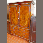 An early George III figured mahogany clothes press,