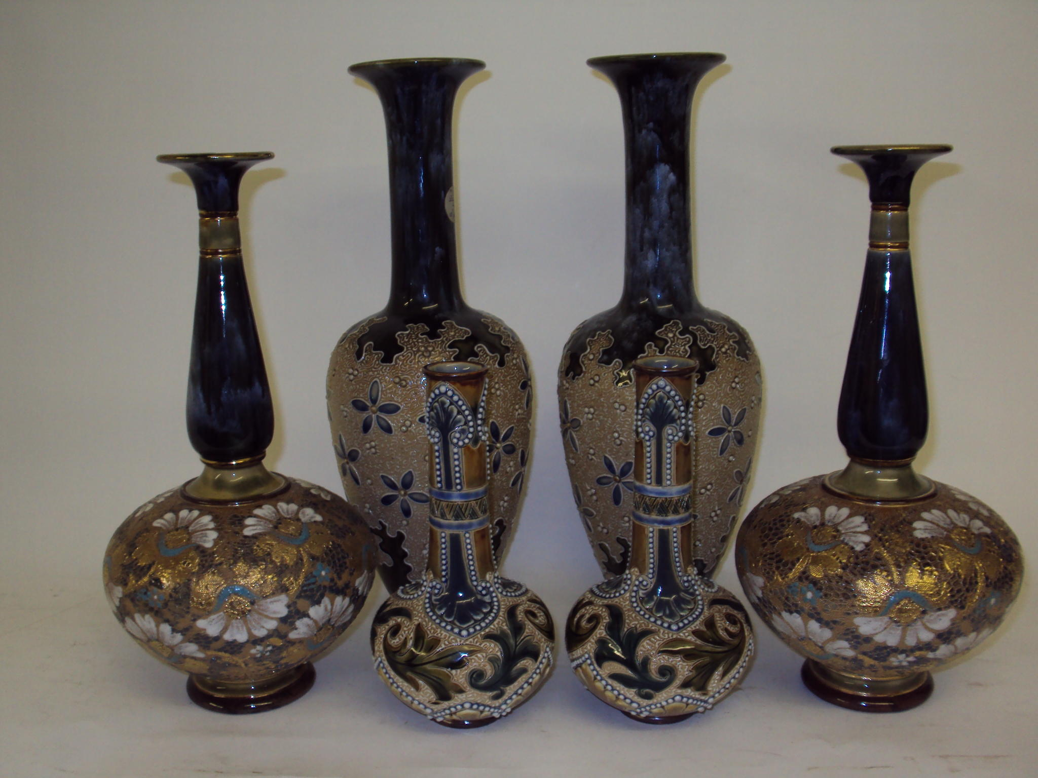 Two pairs of Doulton Lambeth vases and a pair of Royal Doulton Slaters...