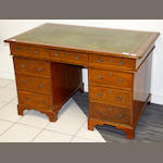 An oak pedestal desk