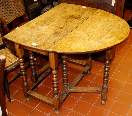 An English oak gate-leg table,