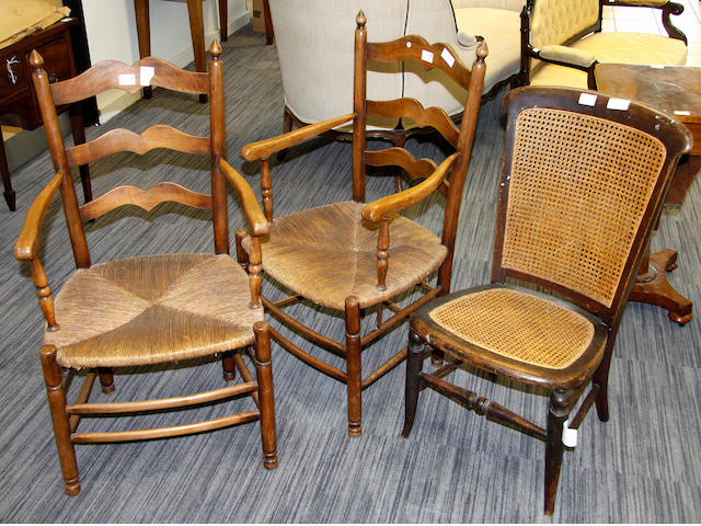 A Victorian beechwood side chair,with cane panel back and seat, a pair of French provincial fruitwood ladderback armchairs with rush seaats (3)