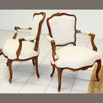 A Louis XV style walnut fauteuil,19th Century with moulded chanelled frame and cabriole legs and another of similar design (2)