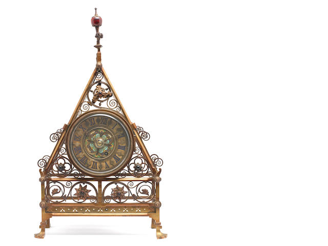 A mid Victorian brass mantle clock attributed to Bruce Talbot