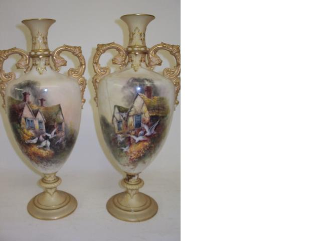 A pair of Royal Worcester vases, signed C.H.C. Baldwyn