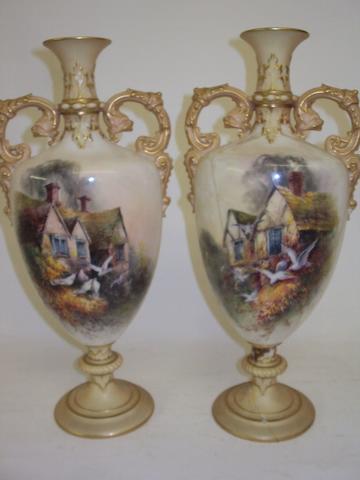A pair of Royal Worcester vases, signed C.H.C. Baldwyn