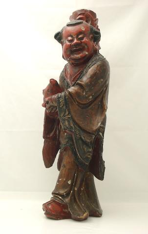 A carved and lacquered wooden figure of a boy 19th/20th century