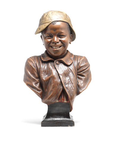 A terracotta bust of a smiling boy, 61cm