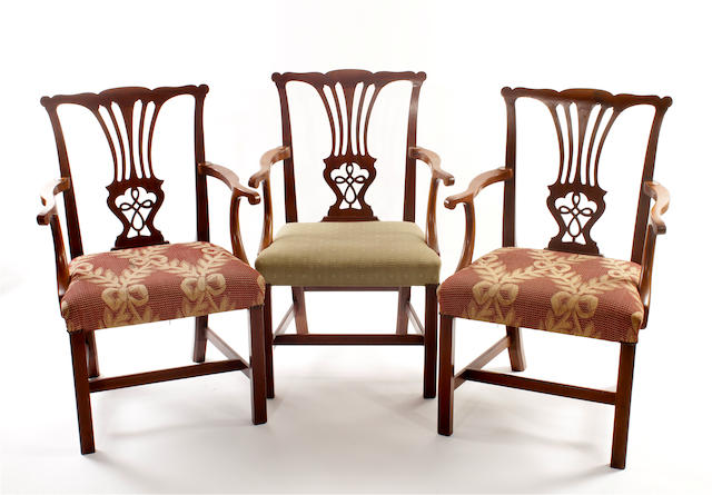 A set of 3 early 19th century mahogany elbow chairs