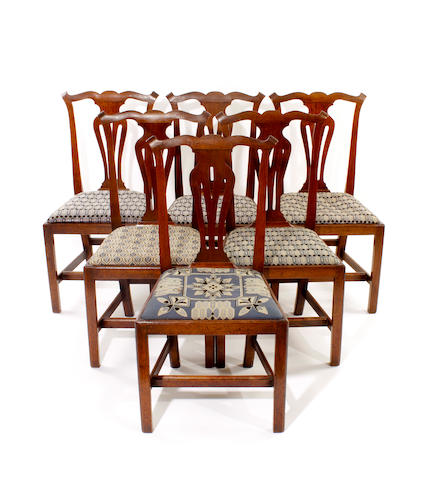 A set of 6 early 19th century Chippendale style oak standard chairs