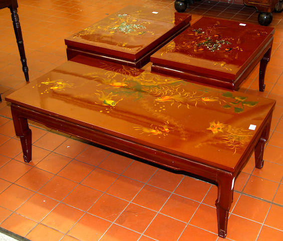 A Vietnamese lacquer low occasional table,the rectangular top decorated with fish swimming amongst weed and other undersea plants, 122 x 61cm and a pair of similar smaller tables decorated in a similar manner, 76 x 51cm, together with two pairs of lacquer vases, the necks and shouldered ovoid bodies inlaid in mother o' pearl with dragons and ho ho birds, each on a stand, 97 x 70cm over all (7)