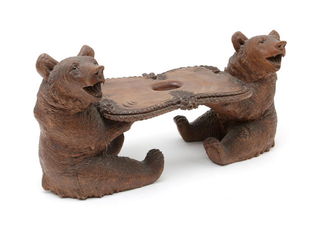 A late 19th century Black Forest carved calling card stand