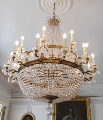 An Edwardian lacquered brass and glass basket chandelier