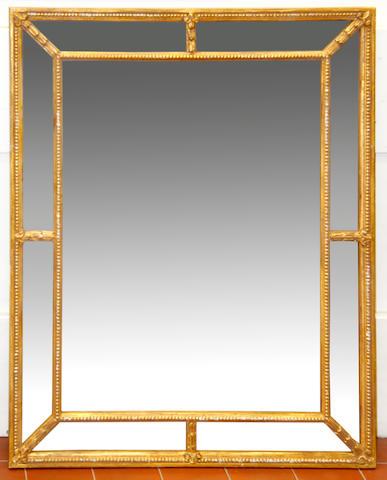 A giltwood marginal mirror