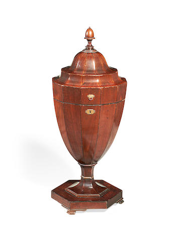 An Edwardian mahogany and ebonised knife urn