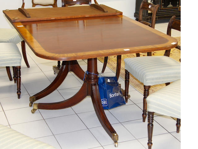 A reproduction twin pillar dining table