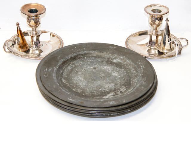 A set of five pewter plates stamped Henry Maxted