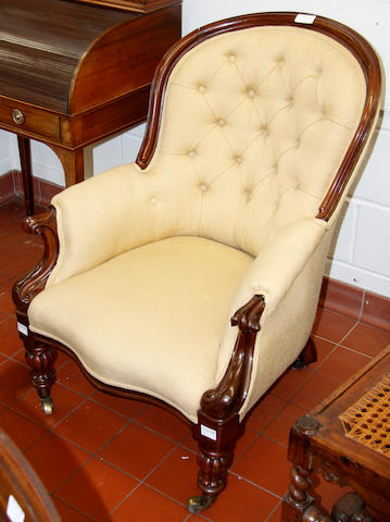 A mid-19th century drawing room armchair