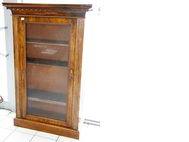 A late Victorian, and later modified, walnut bookcase in two parts