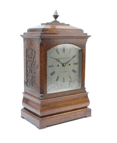 A late Victorian oak cased bracket clock The dial inscribed Muirhead & Son, Glasgow
