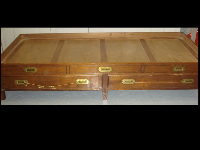 A mahogany and brass bound campaign bed,