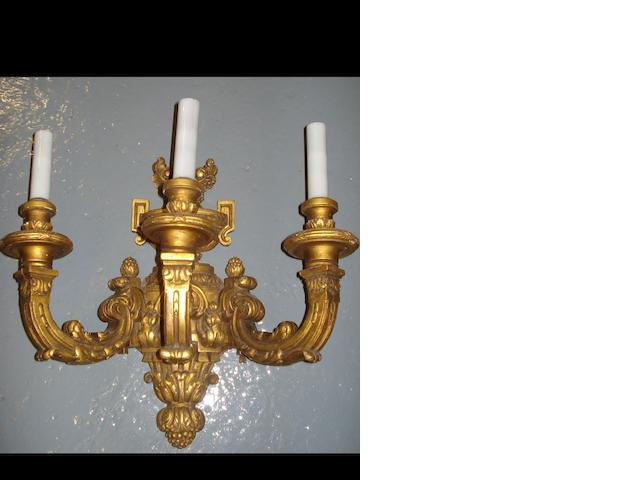 A set of four 18th century style giltwood triple branch wall lights