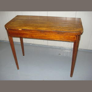 A mahogany card table