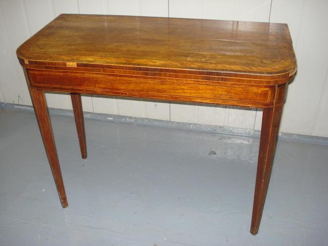 A mahogany card table