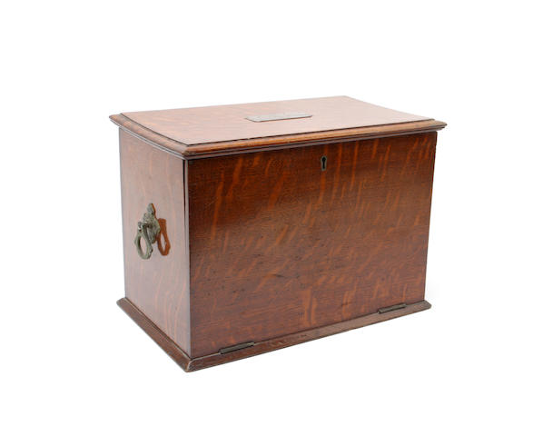 An early 20th century oak stationary box