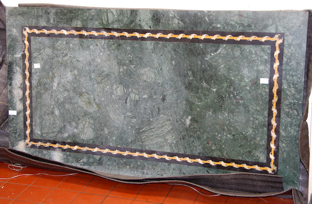 A veined grey marble terrace table top,