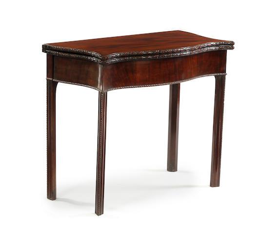 A George III style mahogany tea table,