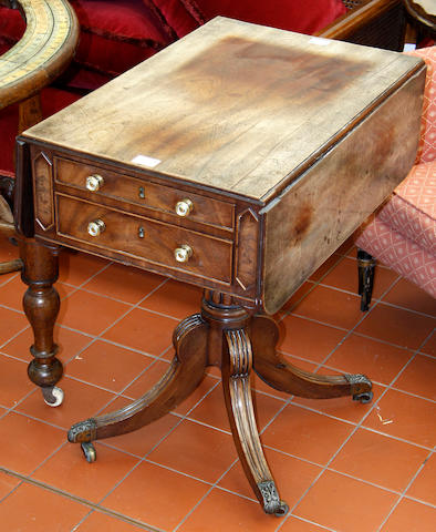 An early 19th century mahogany pedestal sewing table