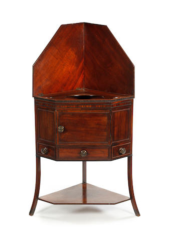 An early 19th century mahogany corner washstand