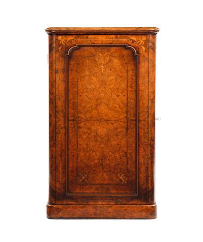 A mid-Victorian figured walnut and inlaid pedestal cupboard