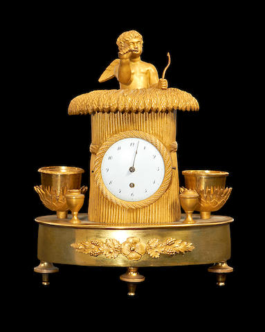 An early 19th century Empire gilt bronze timepiece encrier